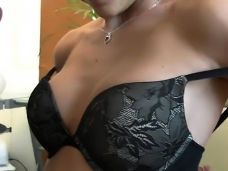 Brunette amateur giving a blowjob in cell phone video