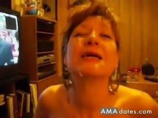 A mature wife takes a load of her hubby's sticky cum all over her face
