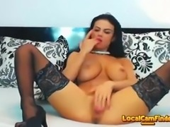 Busty brunette babe stripteasing and fingering her soft pussy