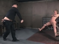 Crucified big breasted blonde Dee Williams undergoes some BDSM treatment
