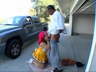 Lovely cheerleader Pinky sucks a guy's cock on a street