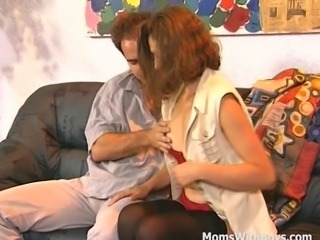 Brunette in fishnet black stockings and stilletos pussy fingered sucking big cock