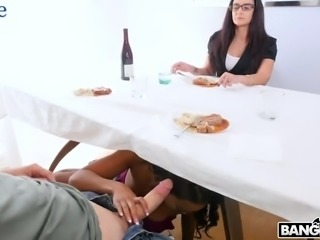 Naughty playful ebony GF Harley Dean sucks delicious cock from under the table