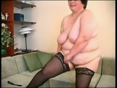 Extremely fat brunette mature housewife exposes her tits and butt