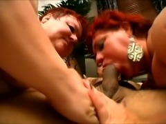 Hot slut Margaret and her fat friend take turns sucking this guy's love tool