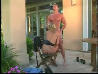 Handsome stud pounding blonde babe's shaved cunt outdoors