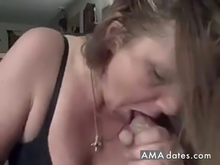 Horny mature gives a sloppy suck