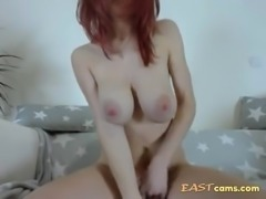 Huge tittied redhead fingering and teasing on the webcam