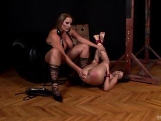 Hot lesbian BDSM session with stunning brunette Laura M