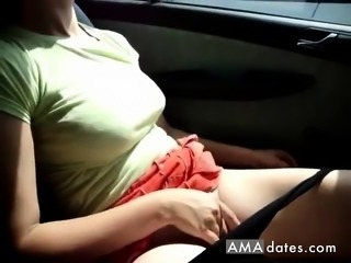 Erect boobed girl masturbates inside car