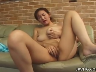 Reiko Kamiya loves masturbating on the couch and she is a handjob expert