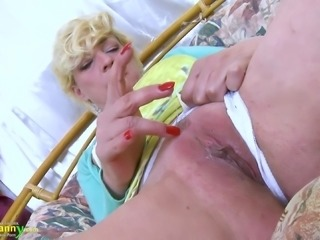 Mature lady showing off her striptease skill and playing with her wet pussy