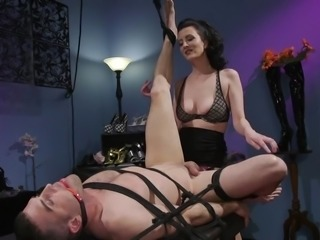 Mistresses don't get much meaner than this. She whips and teases her slave before sticking her huge strap on deep into her slave's tight asshole. She will plow him and not give him a break from the hardcore pegging.