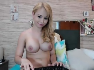 Blonde babe Kagney Karter plays with her big boobs