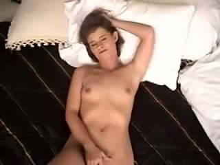 This playful whore loves attention and she loves fingering herself in bed