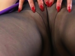 English milf Red takes care of her fanny in tights
