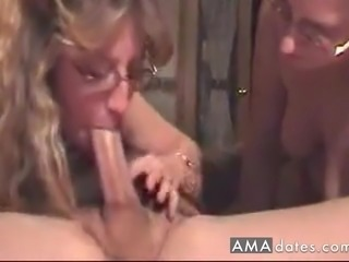 A mustached guy has two blonde matures sharing his dick in bed