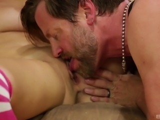 Chesty Ashley Adams grabbing and sucking an older fella's dick