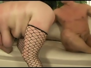 Light haired cutie in black fishnet stockings gives impressive blowjob
