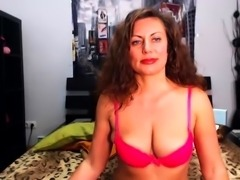Busty mature lady with a hot ass fucks herself on the webcam