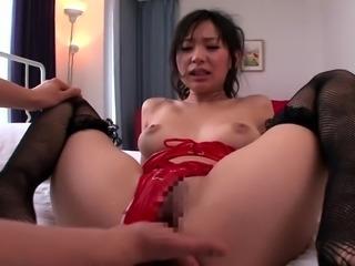 Striking Oriental girl in lingerie engages in hardcore sex