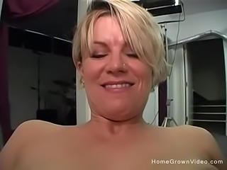 Busty blonde wife strips then sucks