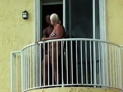 Stacked blonde gets nailed by her black lover on the balcony