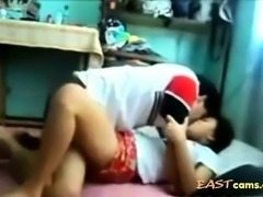 A lovely asian couple fucking hard.
