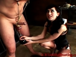 Lingerie-clad dominatrix with a slim body torturing an old man