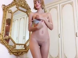 Light haired babe Ariela plays with her natural titties near the mirror