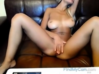 Slut with tanned titties masturbates on livecam