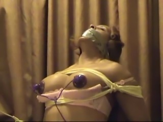 ebony woman bound and gagged for electro stimolation