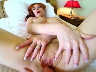 MILF Red gets finger banged under the sheets
