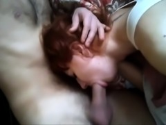 Fiery redhead milf takes a thick cock deep down her throat