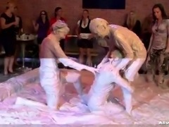 lesbian mud fighters ripping each other's clothes off