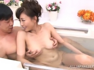 Sexy mature Asian babe has some naughty fun in the bath