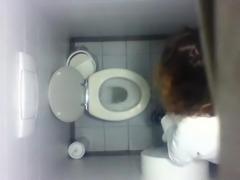 Voyeur real girl wc