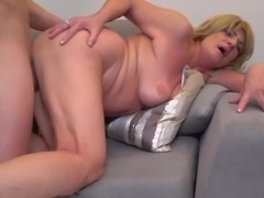 This old blonde is getting plowed by a big dick really hard in her old and...