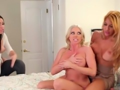 Teen girl pleasuring with two busty moms in the bedroom