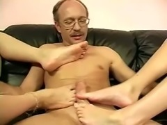 This dude loves having his dick massaged and these sluts give amazing footjobs