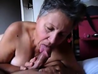 Naughty amateur granny with big breasts sucks a dick in POV