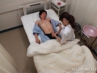 Slim Japanese nurse gives a handjob to her patient