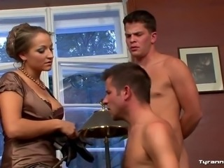 hrny dominatrix punishes two slaves