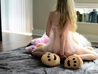 Dazzling blonde teen with lovely boobs rides a teddy bear