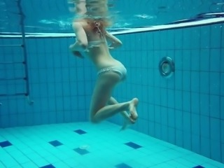 Incredible underwater striptease show performed by redhead Diana Zelenkina