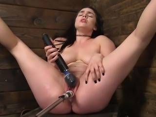 Raven is getting very loud down in the dungeon, but this time it's different. There are no whips, chains, ropes, or anything else to cause her pain. There is only her trusty vibrator and the machine we set up for her. It's great when you can get as many orgasms as you can handle for a change.