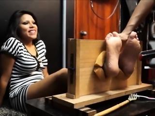 Ravishing amateur brunette getting her lovely feet tickled