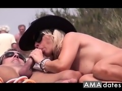 Hot mature wife in cowboy hat sucking dick on the beach