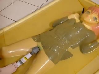 kigurumi vibrating in vacuum bed
