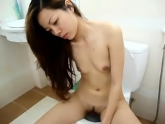 Lovely Thai babe with tiny tits blows and rides a hard shaft